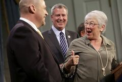 As New York City Mayor Bill de Blasio, center, looks on, New York City Schools Chancellor Carmen Farina, right, talks to President of the United Federation of Teachers Michael Mulgrew during a news conference at City Hall in New York, Thursday, May 1, 2014. New York City and its largest teachers union struck a deal on a new contract Thursday, ending a nearly five-year labor dispute and potentially setting a template for negotiations with the city's other unions. (AP Photo/Seth Wenig)