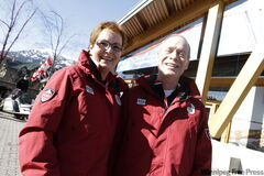 Joan and Eldon Montgomery in front of Canada House on Thursday in Whistler.