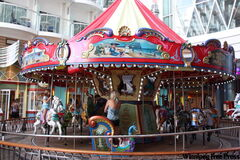 The Carousel on Oasis of the Seas is hand-carved from poplar and runs most of the day on the boardwalk .