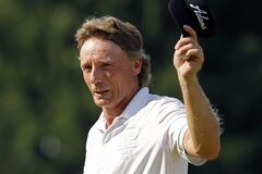 Bernhard Langer of Munich, Germany, walks off the 18th green after parring the final hole of the third round of the Senior Players Championship golf tournament at Fox Chapel Golf Club in Pittsburgh, Saturday, June 28, 2014. Langer shot at 4-under-par 66, giving him the tournament lead at -15. (AP Photo/Gene J. Puskar)