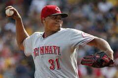 Cincinnati Reds starting pitcher Alfredo Simon (31) delivers during the first inning of a baseball game against the Pittsburgh Pirates in Pittsburgh, Saturday, Aug. 30, 2014. (AP Photo/Gene J. Puskar)