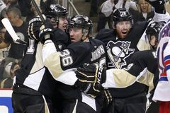 Pittsburgh Penguins' Jussi Jokinen (36) celebrates his goal with teammates Evgeni Malkin, left, and James Neal during the second period of Game 7 of a second-round NHL playoff hockey series against the New York Rangers, in Pittsburgh on Tuesday, May 13, 2014. (AP Photo)