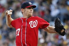 Washington Nationals starting pitcher Stephen Strasburg delivers during the first inning of a baseball game against the Pittsburgh Pirates in Pittsburgh, Saturday, May 24, 2014. (AP Photo/Gene J. Puskar)