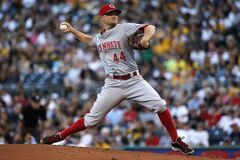 Cincinnati Reds starting pitcher Mike Leake (44) delivers during the first inning of a baseball game against the Pittsburgh Pirates in Pittsburgh Friday, Aug. 29, 2014. (AP Photo/Gene J. Puskar)