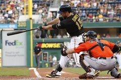 Pittsburgh Pirates' Ike Davis (15) drives in two runs with a bases-loaded double off Miami Marlins starting pitcher Tom Koehler during the first inning of a baseball game in Pittsburgh on Wednesday, Aug. 6, 2014. (AP Photo/Gene J. Puskar)