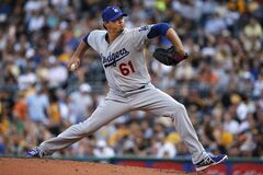 Los Angeles Dodgers starting pitcher Josh Beckett (61) delivers during the first inning of a baseball game against the Pittsburgh Pirates in Pittsburgh Tuesday, July 22, 2014. (AP Photo)