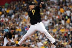 Pittsburgh Pirates starting pitcher Vance Worley delivers during the first inning of a baseball game against the San Diego Padres in Pittsburgh, Friday, Aug. 8, 2014. (AP Photo/Gene J. Puskar)