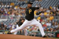 Pittsburgh Pirates starting pitcher Edinson Volquez delivers during the first inning of a baseball game against the Chicago Cubs in Pittsburgh, Thursday, June 12, 2014. (AP Photo/Gene J. Puskar)