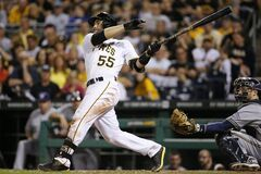 Pittsburgh Pirates' Russell Martin (55) drives in three runs with a bases loaded double off Milwaukee Brewers relief pitcher Tyler Thornburg during the sixth inning of a baseball game in Pittsburgh Friday, June 6, 2014. (AP Photo/Gene J. Puskar)