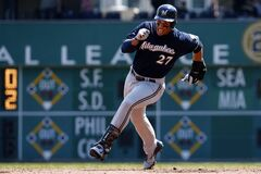 Milwaukee Brewers' Carlos Gomez rounds second and heads safely to third with a triple during the third inning of a baseball game against the Pittsburgh Pirates in Pittsburgh, Sunday, April 20, 2014. (AP Photo/Gene J. Puskar)