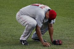 Cincinnati Reds starting pitcher Alfredo Simon collects himself behind the mound during the sixth inning of a baseball game against the Pittsburgh Pirates in Pittsburgh, Saturday, Aug. 30, 2014. The Pirates won 3-2. (AP Photo/Gene J. Puskar)