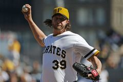 Pittsburgh Pirates relief pitcher Jason Grilli (39) delivers during the ninth inning of a baseball game against the Milwaukee Brewers in Pittsburgh Sunday, April 20, 2014. The Brewers won in 14 innings 3-2. (AP Photo/Gene J. Puskar)