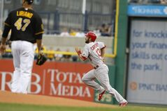 St. Louis Cardinals' Matt Carpenter (13) heads for second past Pittsburgh Pirates starting pitcher Francisco Liriano with a leadoff double in the first inning of a baseball game on Friday, May 9, 2014, in Pittsburgh. (AP Photo/Keith Srakocic)