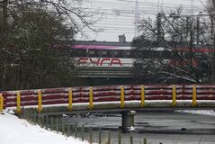 A Fyra high-speed train, shunted by a locomotive passes a bridge on its way to a railroad siding in Amsterdam, Netherlands, Monday Jan. 21, 2013. When railroad bosses proudly unveiled their new Fyra train connecting Amsterdam and Brussels they called it the