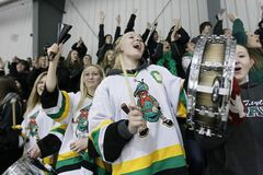 Reanna Rothwell bangs her drum to celebrate a John Taylor Pipers' goal against the Oak Park Raiders in the Winnipeg High School Hockey League championship final at the MTS Iceplex Tuesday.