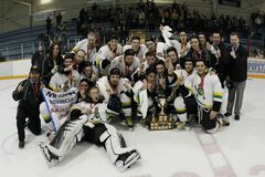 Members of the John Taylor Pipers hockey team celebrate after defeating the Oak Park Raiders 3-1 to capture the AAAA Provincial High School Hockey Championship at the St. James Civic Centre Monday.