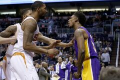 Los Angeles Lakers' Nick Young, right, has words with Phoenix Suns' Marcus Morris and Markieff Morris, rear, during the first half of an NBA basketball game Wednesday, Jan. 15, 2014, in Phoenix. Young was ejected from the game along with Suns' Alex Len. (AP Photo/Ross D. Franklin)