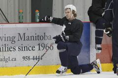 Winnipeg Jets Bryan Little takes part in an informal hockey practice in Winnipeg on Monday.