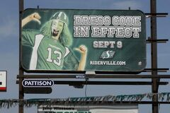 A Saskatchewan Rough Riders billboard erected on Route 90 at Silver encourages a green dress code (with watermelon hats) at the team's Sept. 9 game against the Blue Bombers in Winnipeg.