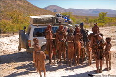 Feuchtwanger and Wilson are greeted by the Himba people from a village in Namibia.