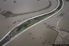 A view from the sky of the Assiniboine River overflowing its banks in Brandon on Thursday.
