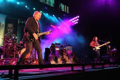 The power trio Rush performs on Nov. 1, 2012, in Atlanta. The Canadian band's long-awaited induction into the Rock and Roll Hall of Fame happened Thursday night in Los Angeles.