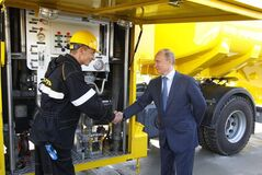 Russian President Vladimir Putin, right, shakes hands with a fuel truck driver, as he visits Rosneft gas station earlier this month.