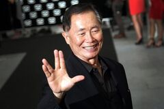American actor George Takei gestures with a hand greeting made popular by the Television series Star Trek arrives at the Marina Bay Sands hotel on Thursday, May 23, 2013 in Singapore for the inaugural Social Star Awards.(AP Photo/Wong Maye-E)