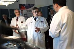 In this file photo, former industry minister Tony Clement visits the National Research Council building in Winnipeg in 2009. Under the Tory government, the council made staff cuts on April 17, 2012.