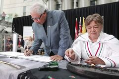 Commission chairman Murray Sinclair signs documents at the U of M Friday.