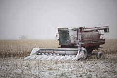Farm equipment sits idle beside Highway 12 near Steinbach as an early snowstorm hit the province Thursday.
