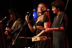 Keri Latimer (right) and Red Moon Road perform at the West End Cultural Centre 25th anniversary concert in Winnipeg Saturday.