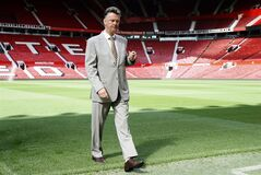 Manchester United's Louis van Gaal walks off the pitch following a photocall for his new player Angel di Maria, at Man. Utd's Old Trafford Stadium in Manchester, England, Thursday, Aug. 28, 2014. Manchester United have signed winger Angel Di Maria from Real Madrid for a British record transfer fee of �59.7 m. The Argentine winger had a medical in Manchester on Tuesday and has signed a five-year deal. Di Maria is likely to make his debut on Saturday against Burnley in the Premier League. (AP Photo/Alastair Grant)