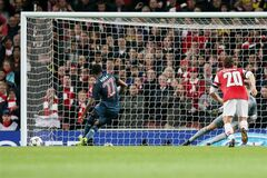 Bayern's David Alaba misses to score with a penalty during a Champions League, round of 16, first leg soccer match between Arsenal and Bayern Munich at the Emirates stadium in London, Wednesday, Feb. 19, 2014 .(AP Photo/Alastair Grant)