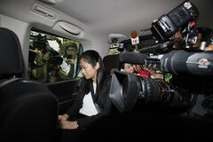 Former fung shui practitioner Tony Chan Chun-chuen's daughter Polly Lon Pui-chun sits in a van after her father had been convicted and fined at the High Court in Hong Kong, Friday, July 5, 2013. The former lover of quirky billionaire Nina Wang has been sentenced to 12 years in prison after a Hong Kong court found him guilty of forging her will to claim her multibillion-dollar estate. A High Court judge on Friday called Peter Chan, formerly known as Tony Chan,