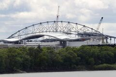 The new Investors Group Field viewed from across the Red River on River Road.