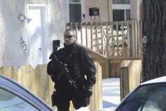Police officer at the scene of a reported shooting on Langside Street Tuesday afternoon.
