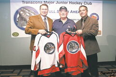 Railer Express coaches Russ Wilgosh (left) and Mike Gordichuk (right) are joined by Jim Johnson, the first coach of the Railers in 1977, to show the new club's sweaters.