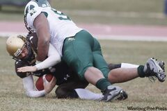 Akiem Hicks of the University of Regina Rams sacks Khaleal Williams of the University of Manitoba Bisons Saturday.
