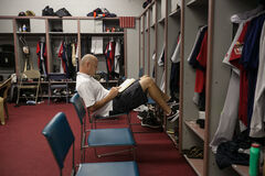 Star pitcher Ace Walker catches a moment before the game to read The Book of God, the Bible written in novel form: 'Maybe God knows my heart better than I do. My priorities have kind of shifted.'