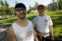 Blind runner Tracy Garbutt (left) and training partner and guide Mike Malyk, stop in Vimy Ridge Park before training session for the Manitoba Marathon.