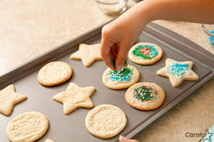 Brush your cookies with a mixture of egg whites and water to make sure decorations stick to your baked goodies.