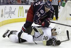 Columbus Blue Jackets' David Savard knocks Pittsburgh Penguins' Brandon Sutter to the ice on Monday, April 28, 2014, in Columbus, Ohio. THE CANADIAN PRESS/AP, Jay LaPrete