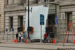 The Divide is shooting outside the Millennium Centre building on Main Street.