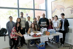 Sisler High School's Free the Children group, pictured fundraising alongside school custodians (and big-time supporters) Jai Surjulall, Jaswinder Chahal, and Doris Crus, will have a busy year of projects ahead of them.