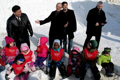 Point Douglas Coun. Mike Pagtakhan, mayor Sam Katz, Central Neighbourhoods Development Corporation executive director Allan Wise and Winnipeg Boys and Girls Club president Ron Brown visit some local kids in advance of a Feb. 22 announcement of over $950,000 for the rec grounds of Freight House, located at the corner of Isabel Street and Ross Avenue.