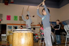 Margaret Park School students Christie Jack, left, and Abigail Garcia learn the art of taiko drumming.