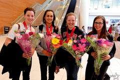 Breanne Meakin (from left), Krysten Karwacki, Ashley Howard and Selena Kaatz arrived home from the CIS curling championships with gold medals.
