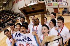 The Garden City Fighting Gophers celebrate their second straight provincial boys' basketball championship. The Gophers trailed the Sisler Spartans by 20 points at halftime but ended up winning 87-84.