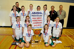 The Linden Christian Wings varisty girls' basketball team shows off the championship trophy after winning the provincial AAA title.